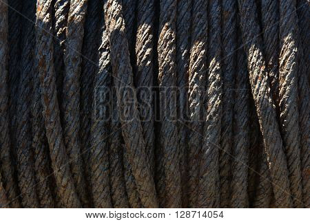 Rusty metal rope on old boat winch