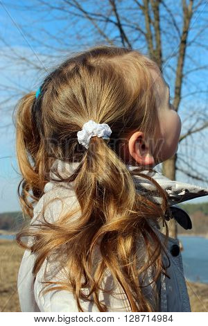little girl with nice hair-do in the nature
