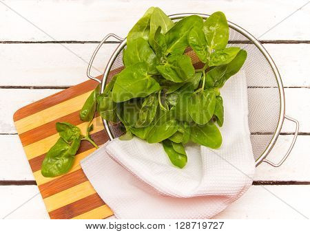 Fresh Spinach Leaves In Basket .