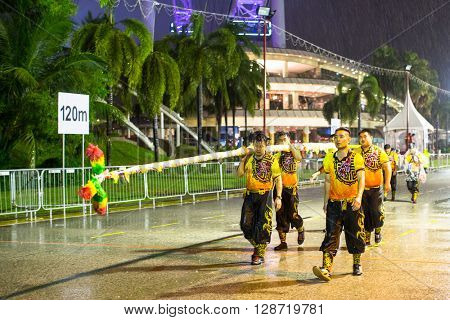 SINGAPORE - JAN 19, 2016: Unidentified participants Chingay Parade. Parade is ranked as largest street festival in Asia. This year braved the rain in the parade was attended by 8,000 participants.