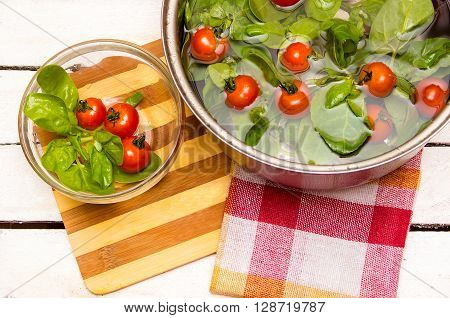 Fresh Spinach, Cherry Tomatoes In A Saucepan With Water