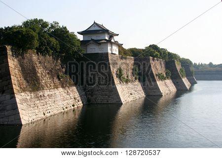 The moat of osaka castle in the morning mist japan