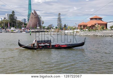 PERTH,WA,AUSTRALIA-APRIL 10,2016: Gondola rides at Elizabeth Quay with view of the Bell Tower in Perth, Western Australia.