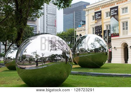 SINGAPORE - JAN 19, 2016: Mirror Balls in Empress Place in front of Asian Civilizations Museum. On Sep 2014, the Museum was named the top museum in Singapore, ranked among Asiaâ??s top 10 museums.