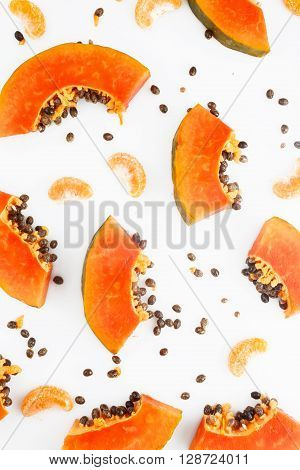 Papaya and mandarine fruit background - top view