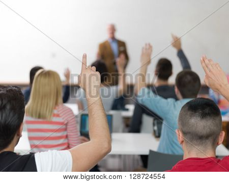 senior teacher teaching lessons, smart students group raise hands up in school  classroom on class
