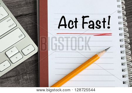 concept of act fast, with desk background