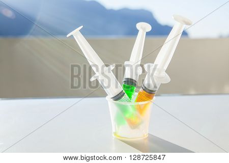 Syringe With Syrup Medicine Use To Feed For Kids.