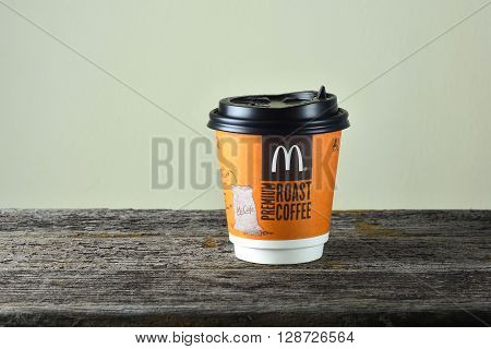 Kuala Lumpur Malaysia - May 06 2016: McDonalds Premium Roast Coffee cup on the rusty wooden table