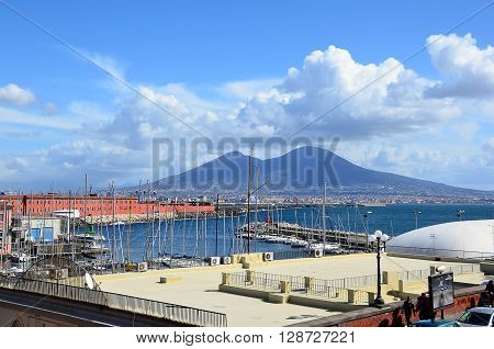 landscape with Naples city harbor and Vesuvius volcano in centre of background