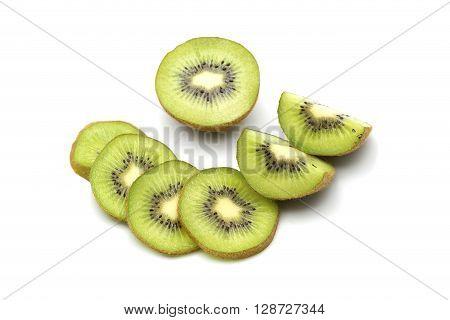 Kiwi fruit and kiwi sliced segments on white background