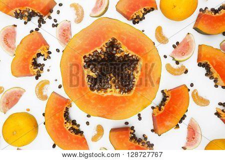 Fruit background - papaya and mandarine on white background