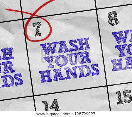 Concept image of a Calendar with the text: Wash Your Hands