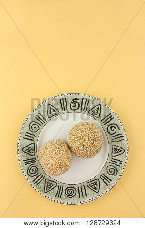 Traditional asian dessert, two sesame balls on the plate