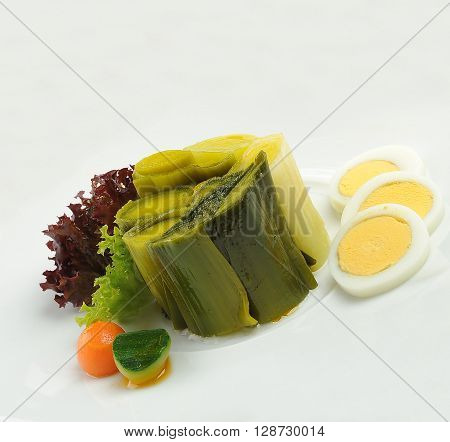 leek dish with eggs on white plate