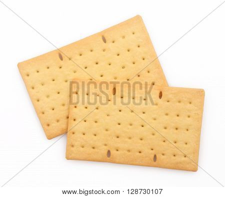 Two biscuits or crackers on white background