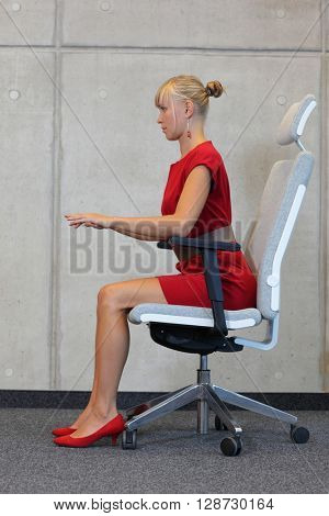 Woman testing office chair - profile