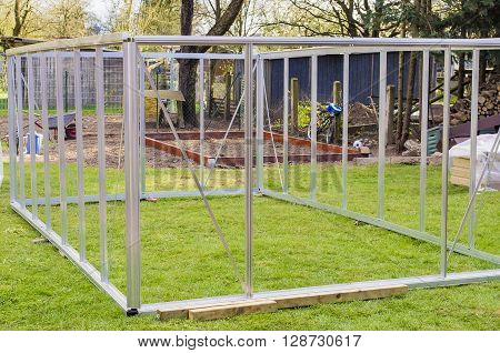 Metal frame made of polycarbonate greenhouses with a gable roof