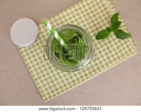 Detox water with cucumber peel and mint