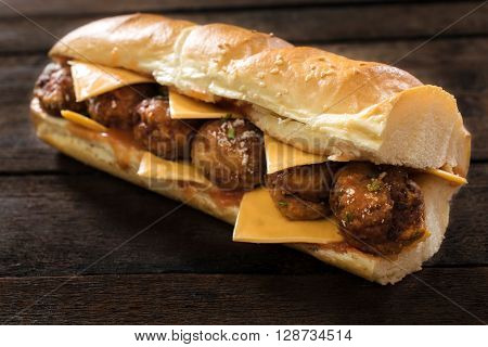 Big And Juicy Meatball Sandwich On The Wooden Background