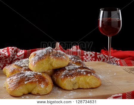 fresh romanian cheese pie with a glass of wine