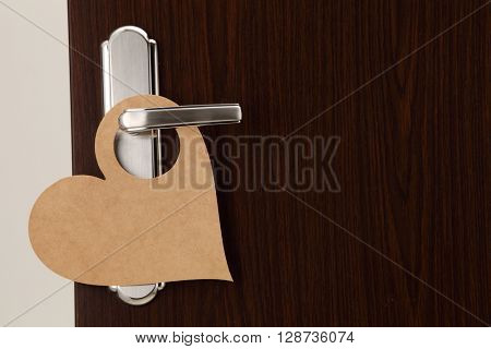 door handle hang with a heart shape door sign for copy