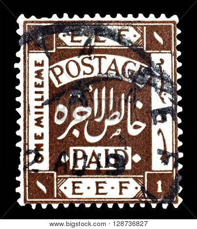 PALESTINE - CIRCA 1918 :  Cancelled postage stamp printed by Palestine, that shows coat of arms.