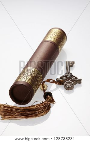 certificate holder and key with tassel