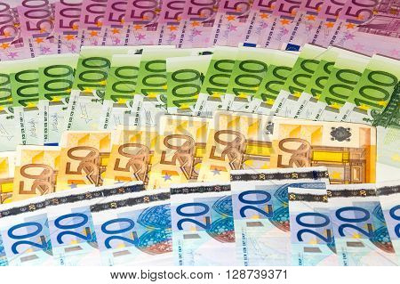 Scattered euro diferent banknotes close up view