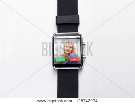 modern technology, communication, object and media concept - close up of black smart watch with incoming call