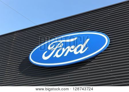 Skanderborg, Denmark - May 5, 2016: Ford logo on a wall. Ford is an American multinational automaker headquartered in Dearborn, Michigan, USA