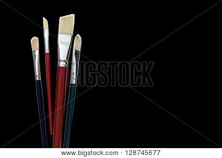 Brushes On Black Background