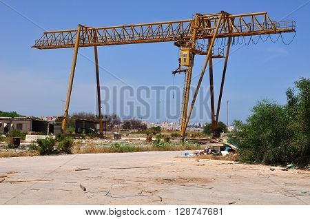 Massive Industrial crane in abandoned factory zone.