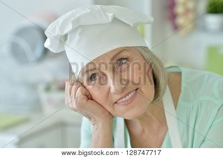 Portrait of a senior chef woman happy ** Note: Visible grain at 100%, best at smaller sizes