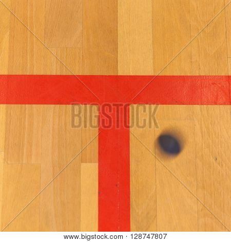 black squash ball on the sqash court