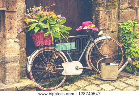 Old bicycle decorated with flowers on the street