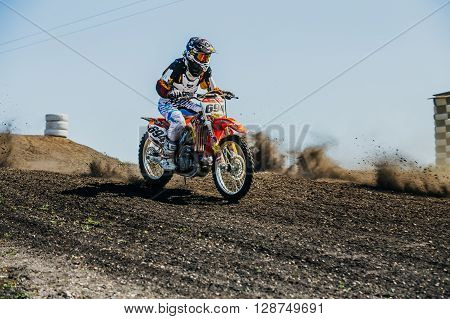Miasskoe Russia - May 02 2016: racer on a motorcycle rides on dusty track during Cup of Urals motocross