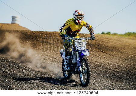 Miasskoe Russia - May 02 2016: athlete a motorcyclist rides along dusty road during Cup of Urals motocross