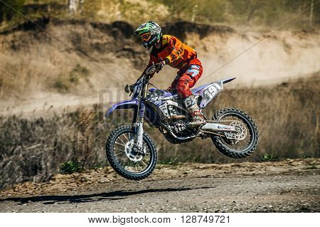 Miasskoe Russia - May 02 2016: racer on a motorcycle jump over race track during Cup of Urals motocross