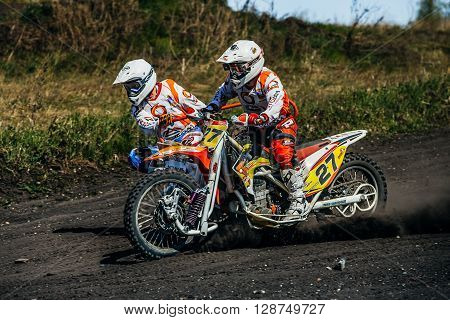 Miasskoe Russia - May 02 2016: closeup of a motorcycle with sidecars riding along a dusty track during Cup of Urals motocross