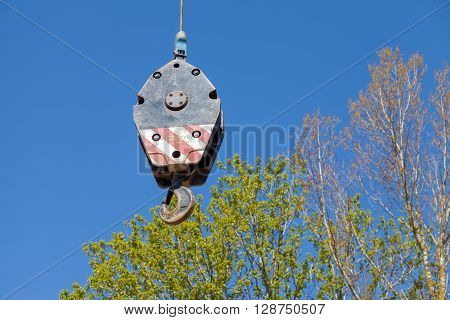 crane hook on tree and sky background