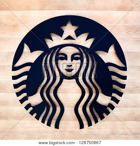 SAINT PETERSBURG, RUSSIA - AUGUST 04, 2015: close up shot of Starbucks logo. Starbucks Corporation is an American global coffee company and coffeehouse chain based in Seattle, Washington
