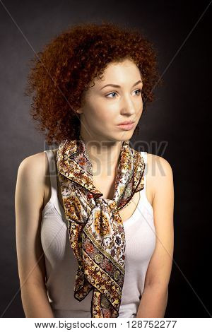 Studio Portrait Of Elegant Young Red Haired Woman In A Neckerchief On A Dark Background