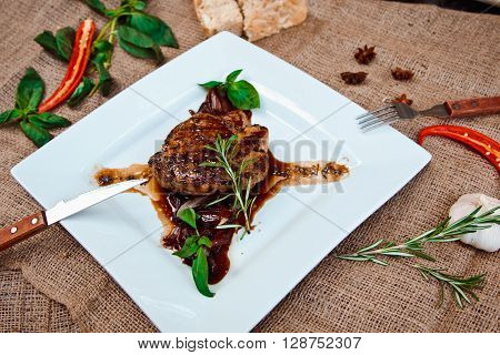 Beautiful Juicy Pork Steak Cooked On The Grill With Caramelized Onions