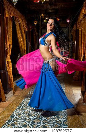 Beautiful Belly Dancer Young Woman In Gorgeous Pink And Blue Costume Dress. Beautiful Brunette With