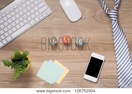 Fathers day composition - office desk. Studio shot on wooden background.