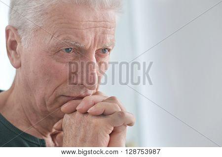 Portrait of a sad senior man face