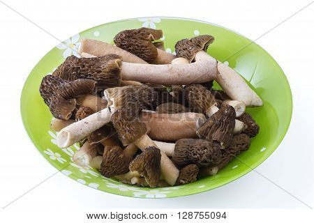 morel mushrooms on a plate isolated on white background