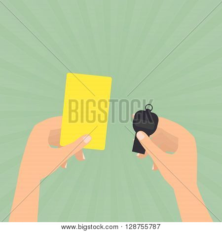 Referee hands hold a yellow card and whistle on sun rays green background.