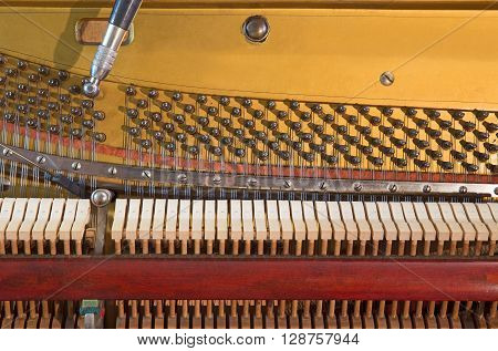 Image of the Interior of an old piano